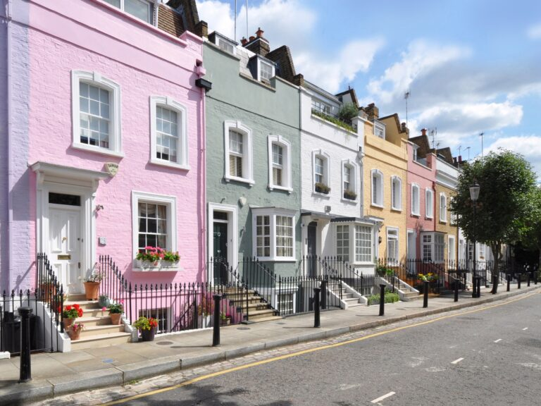 A terrace of houses all painted a different colour